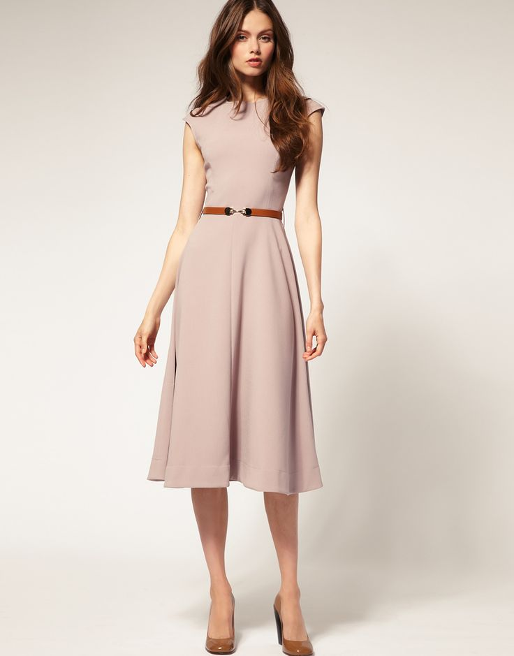 tailored top with soft, knee length skirt