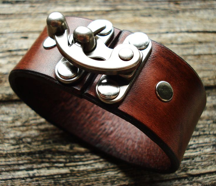 Love these cuffs. Customizable Leather Clasp Cuff 1.5 inch. $27.50, via Etsy.
