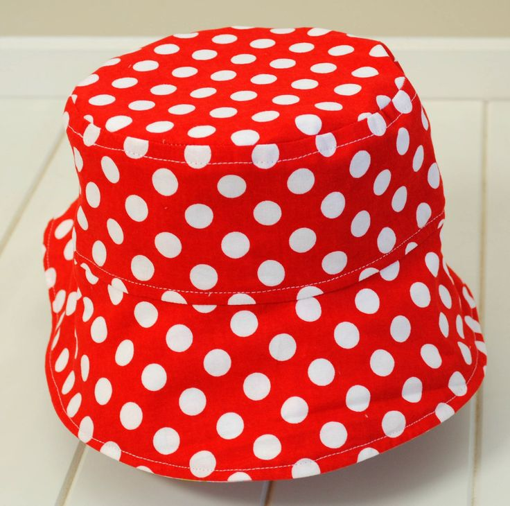 Reversible ponytail hat red spots