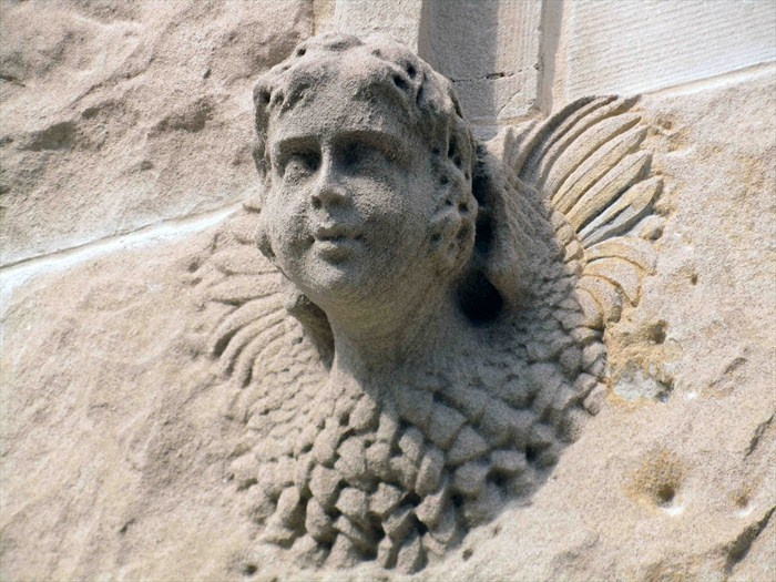 Two angelic faces heads were carved in very high relief of
