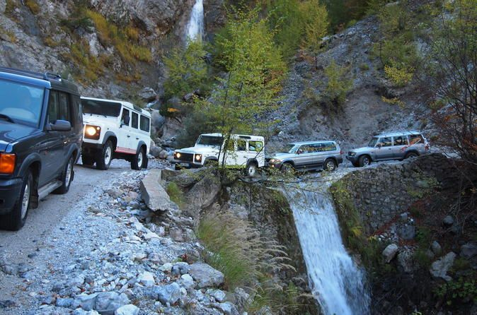 """Theth Albania Jeep Day Tour Enjoy round-trip transportation from your hotel to the jeep departure point. Explore the village of Theth by 4x4 jeep, offering comfort and security while you drive through the village streets. Visit the """"Kulla,"""" tower of Theth, see the village canyon, Grunas waterfall and the natural spring referred to as the Blue Eye.After pick-up from your hotel, arrive by jeep to the village of Theth and visit a location that tourists don't miss when they..."""