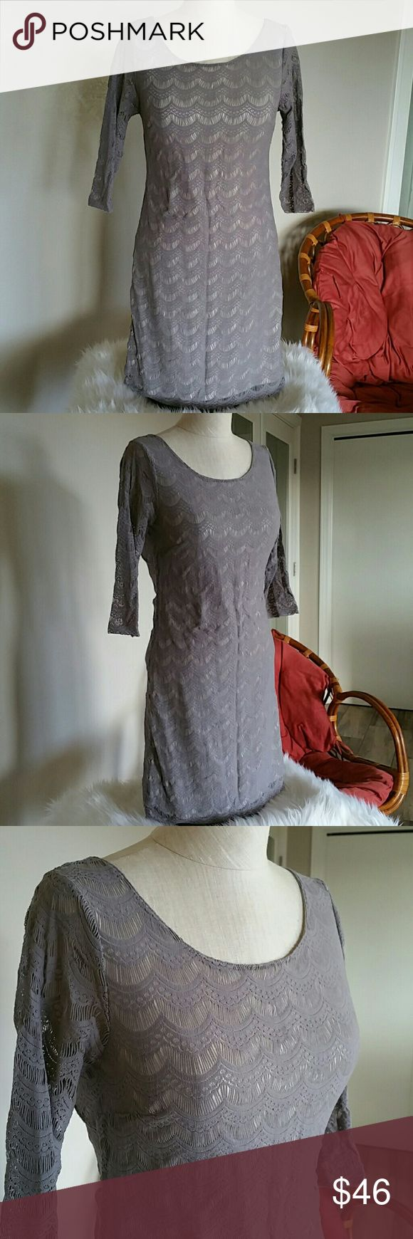 Free People Grey/Silver Bodycon Dress Size small Silver /grey knit Bodycon Open back Perfect for a holiday party🌲 Euc may have been worn once and in like new condition Free People Dresses Mini