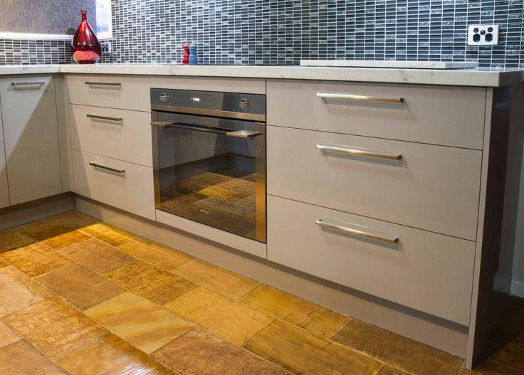 U shape contemporary kitchen. Slate floors. Laminate cabinets. www.thekitchendesigncentre.com.au