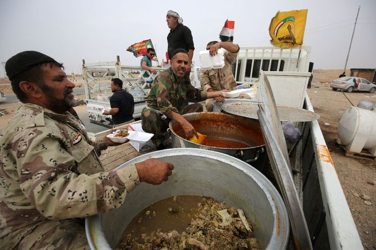 Abu Ahmed drove all night and half-way across Iraq to bring the meat stew and rice in the back of his pickup truck to fighters on the Mosul front lines.  Seven hours after leaving the Shiite holy city of Najaf in a convoy, he stopped under a road sign saying the northern city of Mosul, the Islamic State