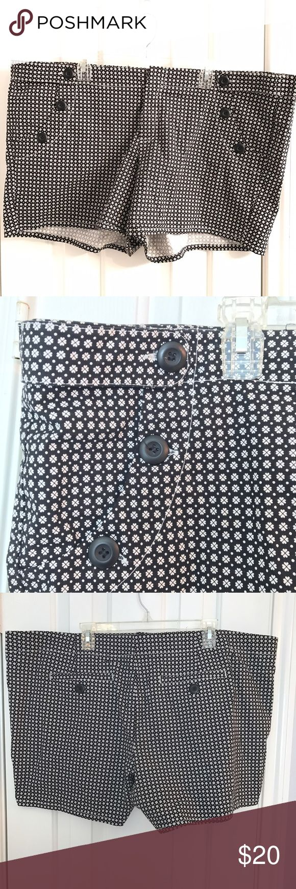 Torrid women's black and white shorts plus size 24 Torrid women's size 24W. Black with white Floral print shorts. Hidden front clasp and zipper. Front pockets with black accent buttons. Back pockets. Gently used, no flaws. torrid Shorts
