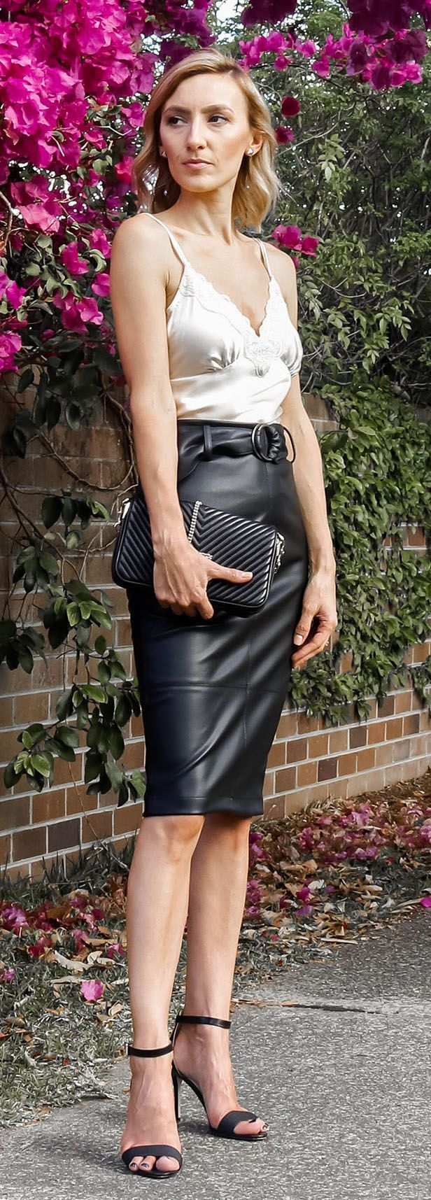 Black leather skirt, long leather skirt, high waited skirts with belt, cream silk cami, black scrappy heels, black clutch bag, spring style, autumn style, pink flowers, street style @thelustlife_