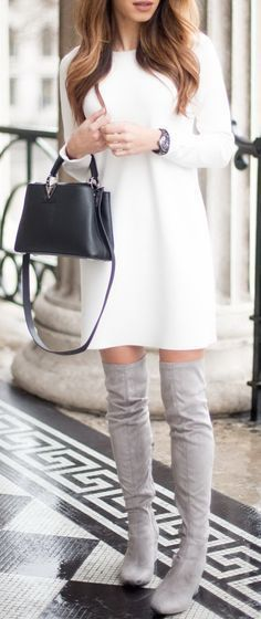 Lots of sweater dresses, boots, long coats & scarves this season!
