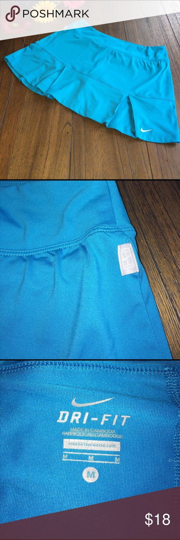 NIKE Tennis 🎾 Skirt Gently used NIKE tennis 🎾 skirt. Pics don't do the color justice--bright turquoise. Pleats at bottom. Built in compression shorts. Size Medium. Nike Skirts