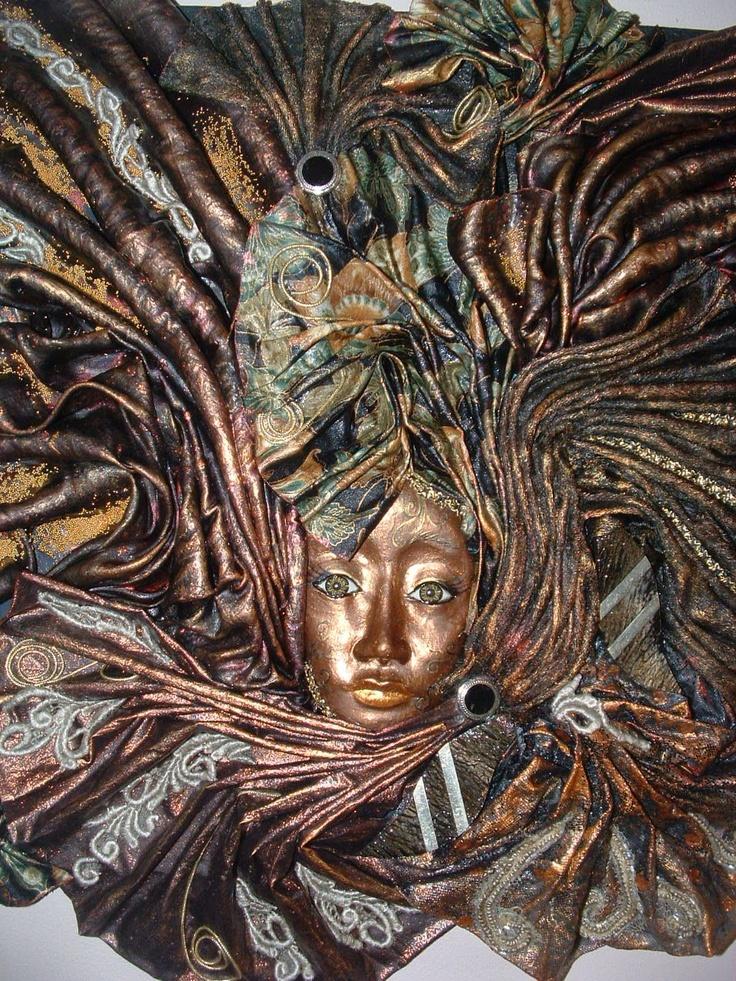 masks, garden angel, statue (tplugers@gmail.com)