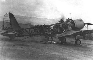 A destroyed Vindicator at Ewa field, the victim of one of the smaller attacks on the approach to Pearl Harbor.