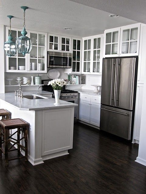 Kitchen - white cabinets, dark hardwood floors, white/gray granite counters