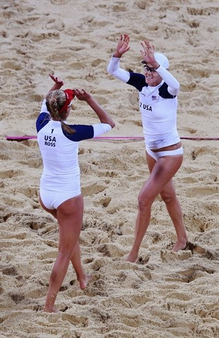 Jennifer Kessy and April Ross of the United States celebrate during Women's Beach Volleyball Preliminary match