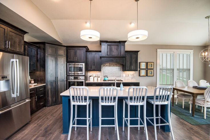 A touch of blue defines the island in this distinctive kitchen. The Cherry Creek II plan, a new home by Summit Homes. Reserve at Prairie Highlands. Olathe, KS.