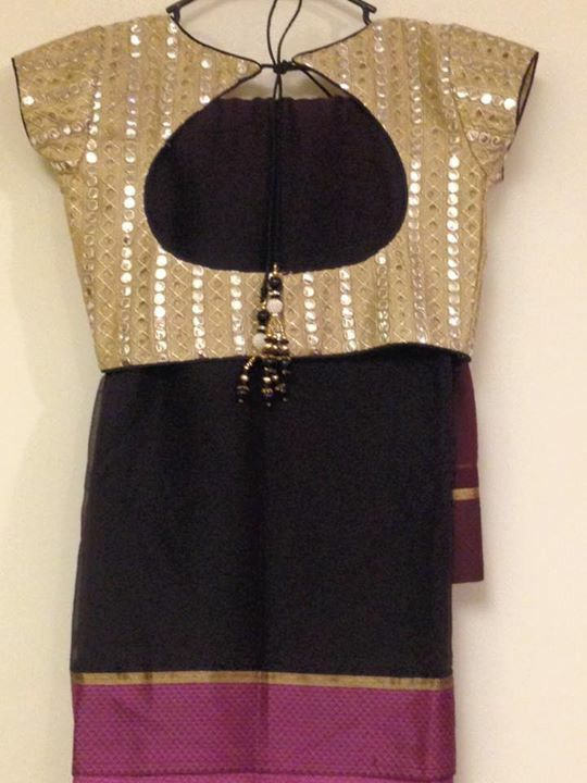 Any simple saree can be stunning with the right blouse like this black saree with gold mirror work blouse