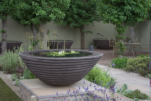 beautiful contemporary bowl water feature/ pond by Cleve West