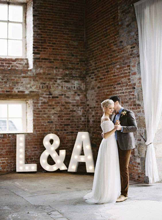 marquee monogram lighting in industrial loft wedding venue @myweddingdotcom:
