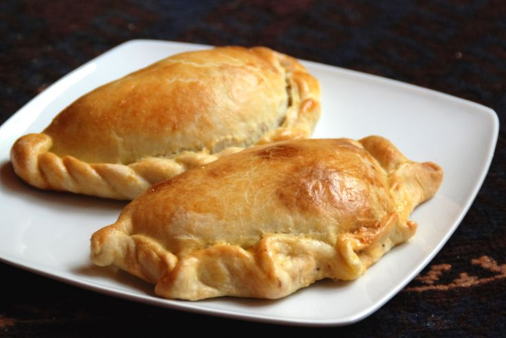 These traditional Chilean empanadas are filled with an unusual mixture of ground beef, onions, raisins and black olives.