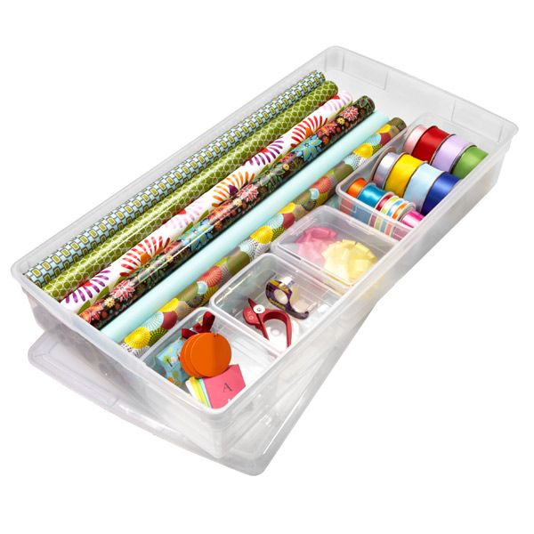 Gift wrapping storage. Small containers inside organize smaller items like ribbon, tape, scissors and more. (From the Container Store)