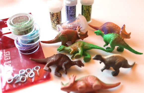 Elliot and eve to decorate for my tree glitter dinosaur ornaments