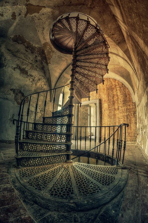 Circular staircase in an abandoned palace in Poland.