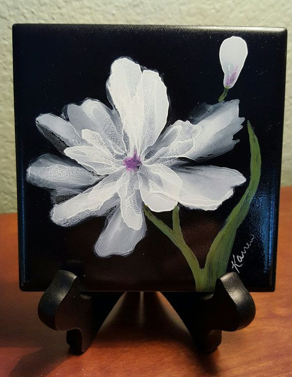 This is original alcohol ink artwork on a 4x4 ceramic tile. It has been sealed and is ready for display. The tile comes with an attached sawtooth hanger on the back so you can hang it on a wall OR you can display it as shown on a plate stand or other small easel. (display holder NOT