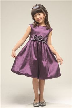 Your little girl will feel so pretty in this flattering bubble dress. She'll love how the taffeta fabric shimmers in the light. She'll also be surprised at how comfortable she feels; she'll be able to twirl in it all day! Beautifully hand crafted rosettes have been sewn on the waistline for an elegant look. Also available in Red