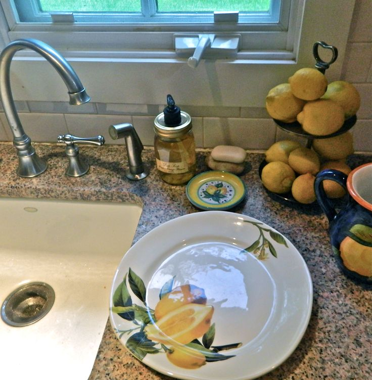 it's all lemons for me this Fall with fun kitchen styling -- using lemon dish soap and a gorgeous plate from @HomeGoods mixed with my Italian lemon pottery and silver #HappyByDesign http://nestnestnest.blogspot.com