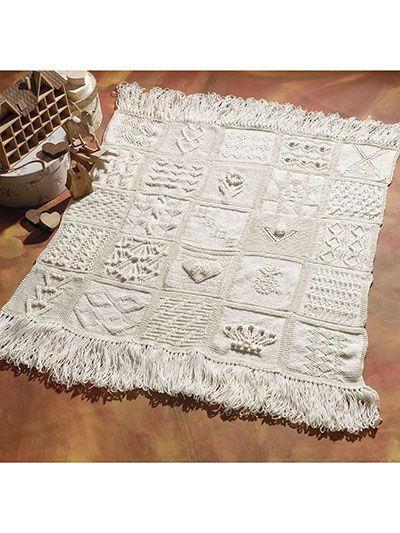 """Experience stitching the way it was meant to be with these 25 creative block patterns. Discover exciting, new blocks such as Imperial Twist, Cable Twist, Triplet Cable, Raised Heart, Sunflowers and more. Stitch and mix your blocks to make any number of creative designs. Finished size 48"""" x 48""""."""
