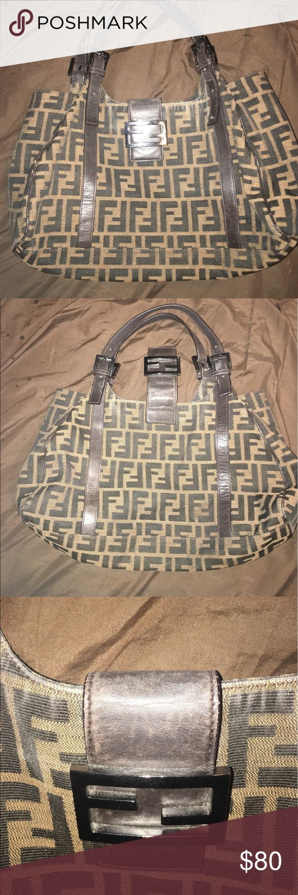 Fendi purse Great fendi purse with allots of life left. Wear pictures on the inner handles of purse. It other then that in great condition Fendi Bags