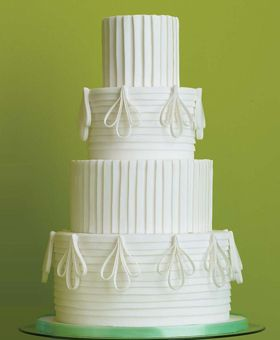 With inspiration from a crisp white tuxedo shirt Kleinman created this dapper cake of fondant pleated cake with sugar-paste filigrees.