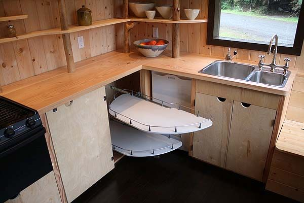 Very clever kitchen storage system; lazy susan system squeeze every bit of storage out of this kitchen.