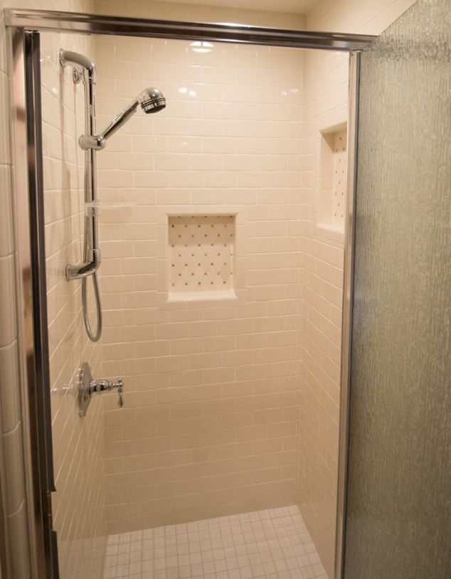 Biscuit Subway Tile Shower With Tumbled Stone Mosaic