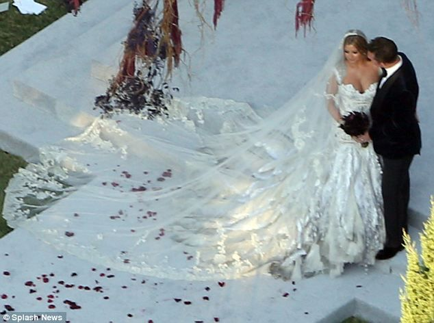 Holly Valance with her new husband Nick Candy at their wedding ceremony in Los Angeles this weekend.