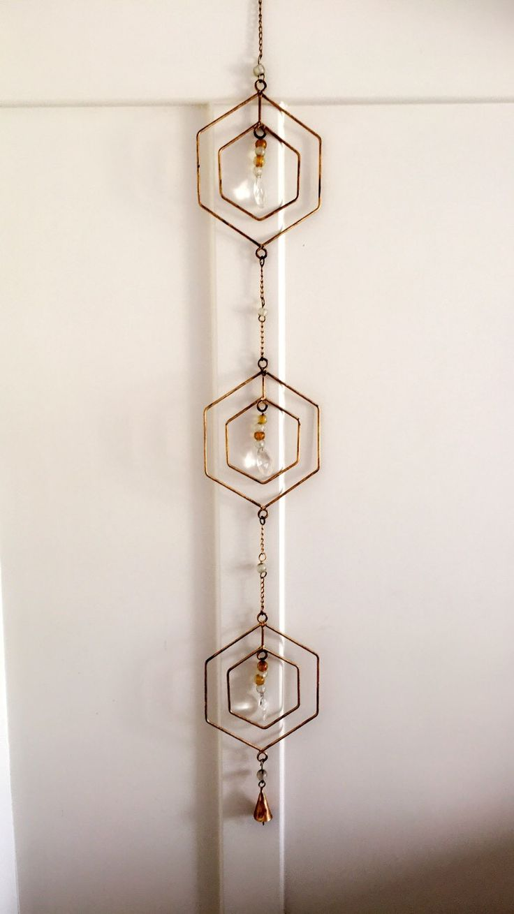 This beautiful piece represents the Geometric & Modern look of the Hexagon Shape Each is made from metal, and polished with a shimmering gold and clear crystal. Hangs around 3 feet long. *Chain links