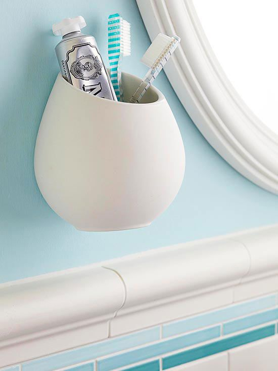 On-the-Wall Storage  The vanity or sink top is generally the only countertop surface in a small bathroom. Maximize that space by making smart storage choices. Corral dental care items -- ones that often end up gobbling up counter space -- in wall-hung containers that are dishwasher-safe, such as this kitchen utensils holder. Attach it to a wall using an anchor screw.