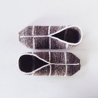 A simple garter stitch slipper pattern knitted flat and seamed with neat crocheted finishing. The pattern is written for women's size large but the size is easily customized.