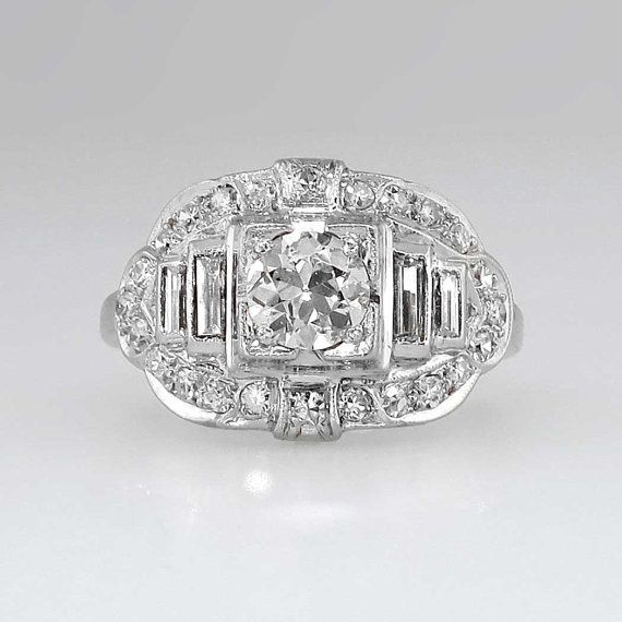 Look at this stunner! It has an impressive look aand is over 70 years old! Sparkling antique cut diamonds. Baguette and single cuts surrounding