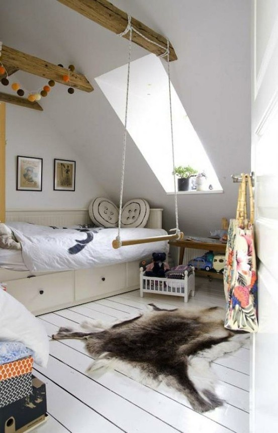 A trapeze-style swing hangs over a reindeer skin rug in a children's room in Denmark via Nordic Bliss.  www.remodelista.com