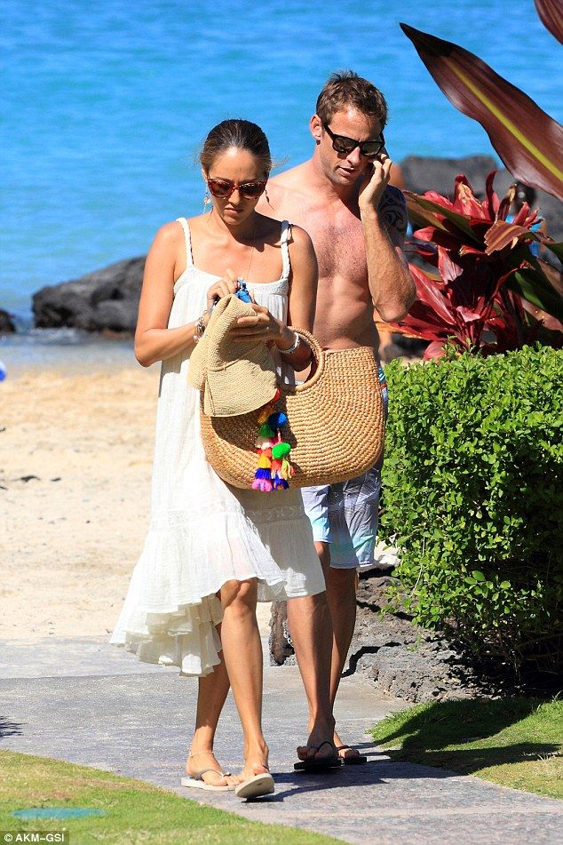 Jessica Michibata and Jenson Button The married couple will be heading home soon after their honeymoon in Hawaii. Jessica carrying our JADEtribe beach basket with tassel!