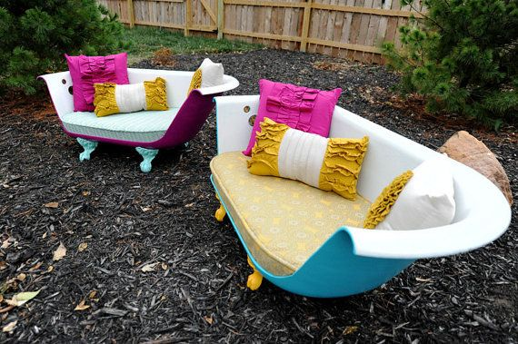 Vintage cast iron claw foot bathtub recycled into two indoor/outdoor couches! Way cool DIY!