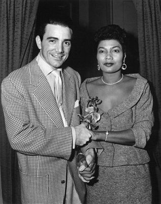"Pearl Bailey and her husband Louie Bellson backstage at ""House of Flowers"" where she is starring in the show in New York City 01-22-1955"