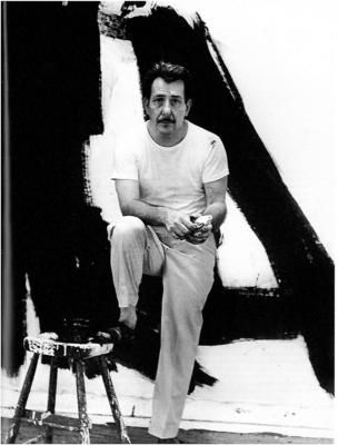 Franz Kline and one of his monumental Abstract Expressionist paintings (photo by Aaron Siskind)