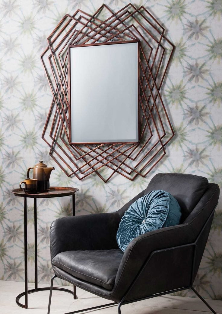 Give your wall the ultimate wow factor with the Caster Geometric Mirror. Featuring a bold geometric frame in an burnished copper finish