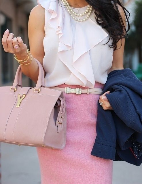 Channeling Legally Blonde in a pink pencil skirt, ruffled top and Saint Laurent bag.