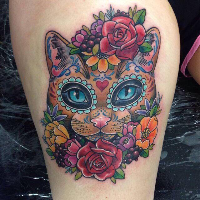 Cool kitty tattoo.