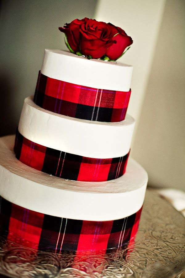 Tartan Wedding Cake. This is almost exactly what i want. Want Fraser tartan ribbon around the base of each cake, roses balanced on the lower tiers, and a biker themed cake topper on top.