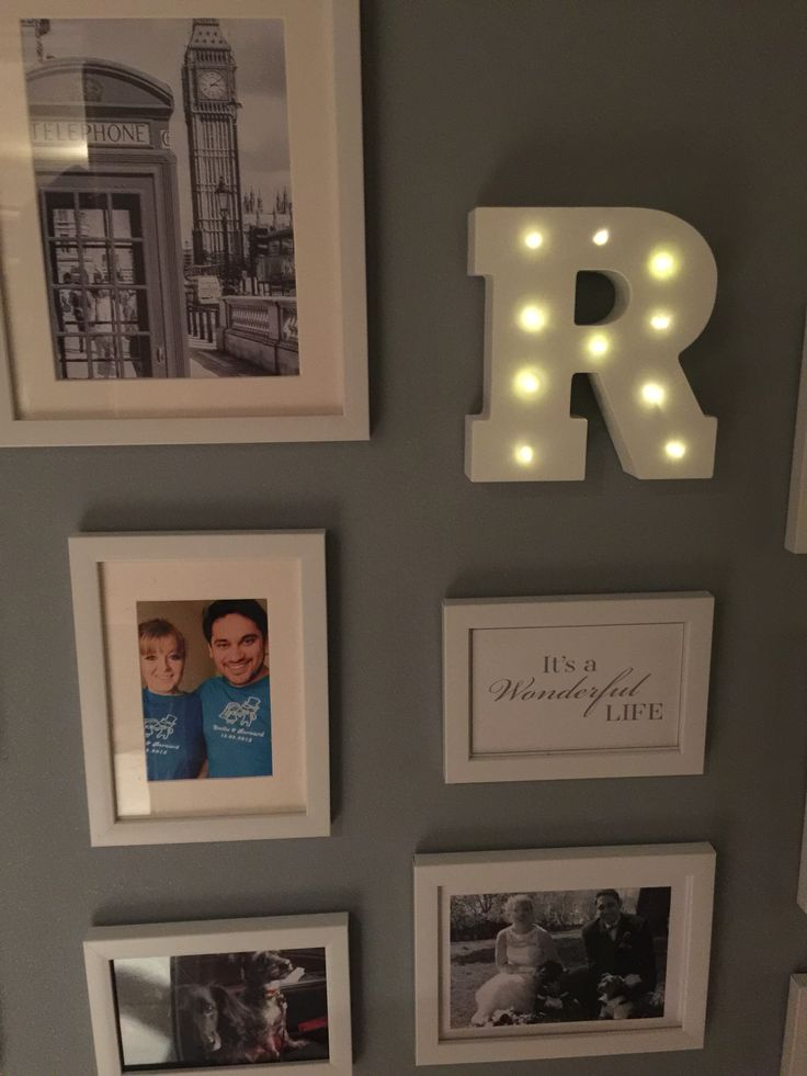 White pictures frames and letter R