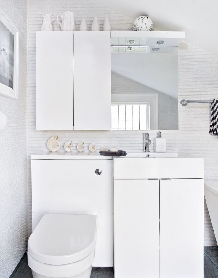 Units around the basin and WC provide neat storage in a compact bathroom. Mix finishes, not hues, to create a look that's simple, but interesting.