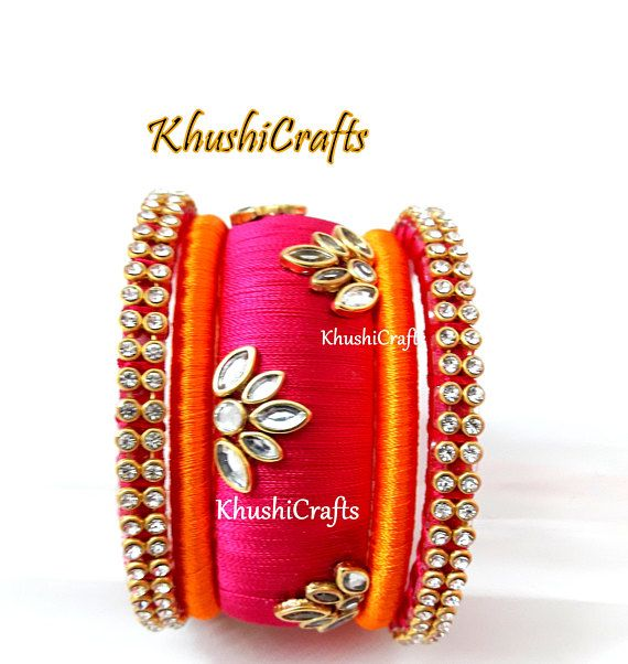 Orange and Pink Kundan Silk thread Bangles -Handmade Indian Jewelry This jewelry listing set consists of one set of bangles as indicated . Note: The product shipped will be same as shown in the picture however, actual colors may vary slightly from those shown due to the nature of