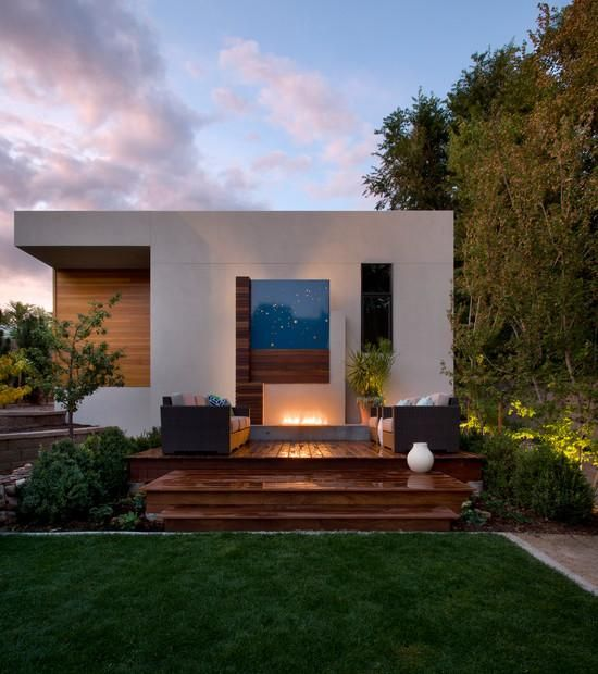 moderne terrasse holz dielenboden lounge sitzgruppe kamin - Steinplatte Kamin Surround